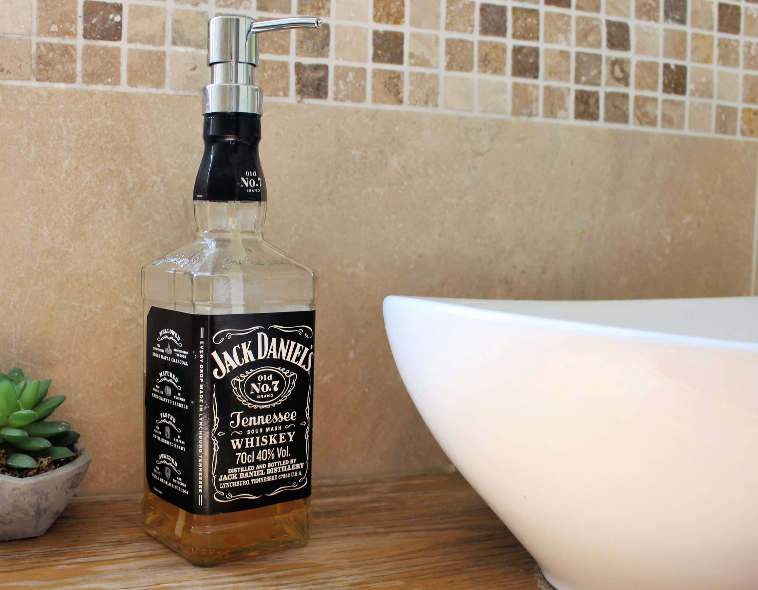 Re-purpose an old bottle by making a soap dispenser!
