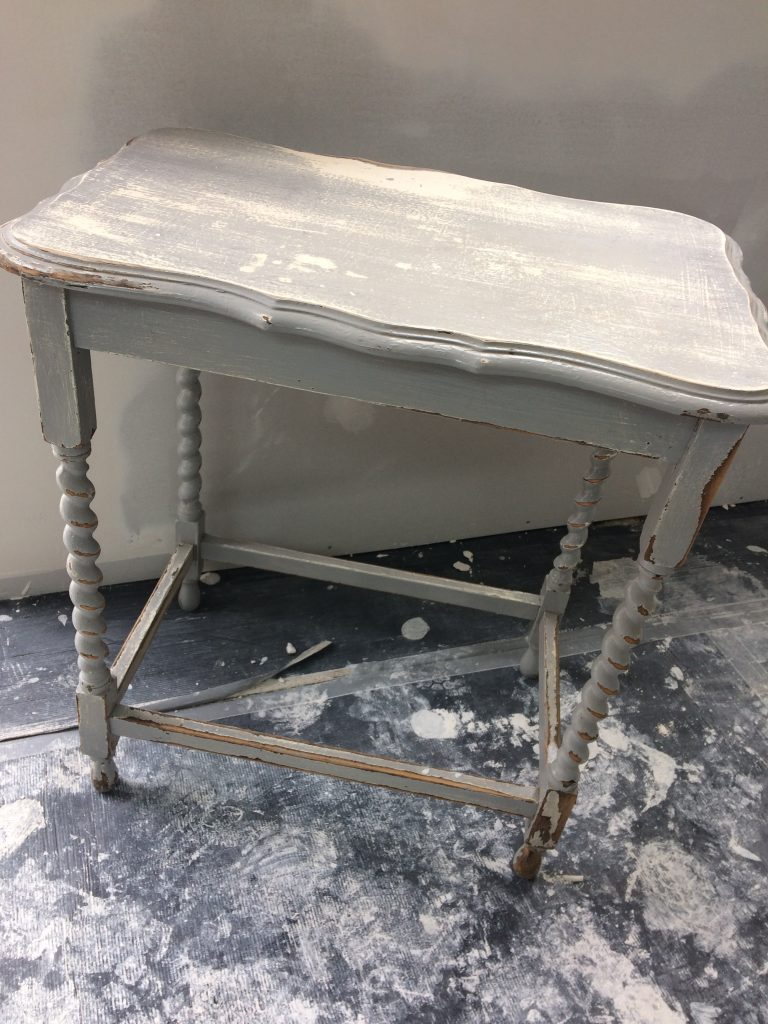 This table was covered in paint but had great potential.