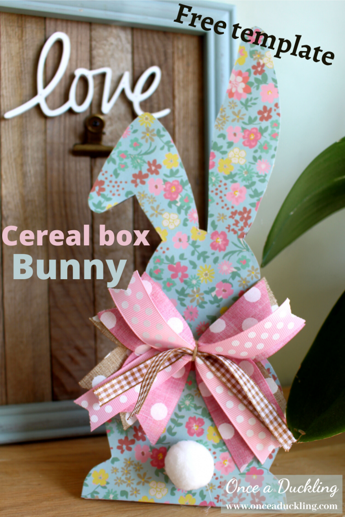 With the shops closed for the coronavirus, I'm using craft supplies around the house to make some colourful Easter decorations. And a good old cereal box was the basis for this gorgeous Easter bunny. With a free template to cut the design, as well as some supports to make sure it stands up. Find yourself some colourful card and some ribbon and you can have this bunny done for your Easter table decorations in no time at all. Kids will love to get involved too!