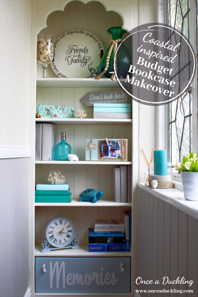 Have you ever thought about styling your bookcase by painting your books?  No? Me neither.  In fact I thought it was pretty crazy at first.  However, turns out it's the perfect idea for a budget DIY makeover of your bookcase.  Check out the before and after of this coastal inspired makeover on a budget.