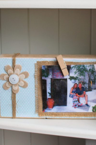Who doesn't love photos to recall all those special moments and memories? We've got loads of them around the house, but also so many on our phones! To have a change from the traditional picture frame, I took a bit of scrapwood to create this unique DIY picture frame. And I'm thrilled with how it's turned out. It looks so cute in our bookcase. Check out how you can make your own budget, craft DIY picture frame with some basic materials! #picture #picture frame #frame #DIY #scrapwood