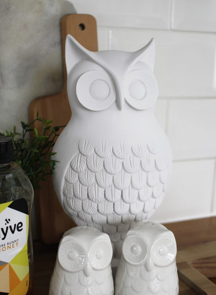 Updating an old item to bring it up to date for your home can be as simple as a lick of paint.  Or a spray of paint in this case.  Check out how this outdated owl went from brassy and old-fashioned to modern and stylish.  All with a can of chalk spray paint.  #budget #budget decor #decor #budget makeover #spray paint