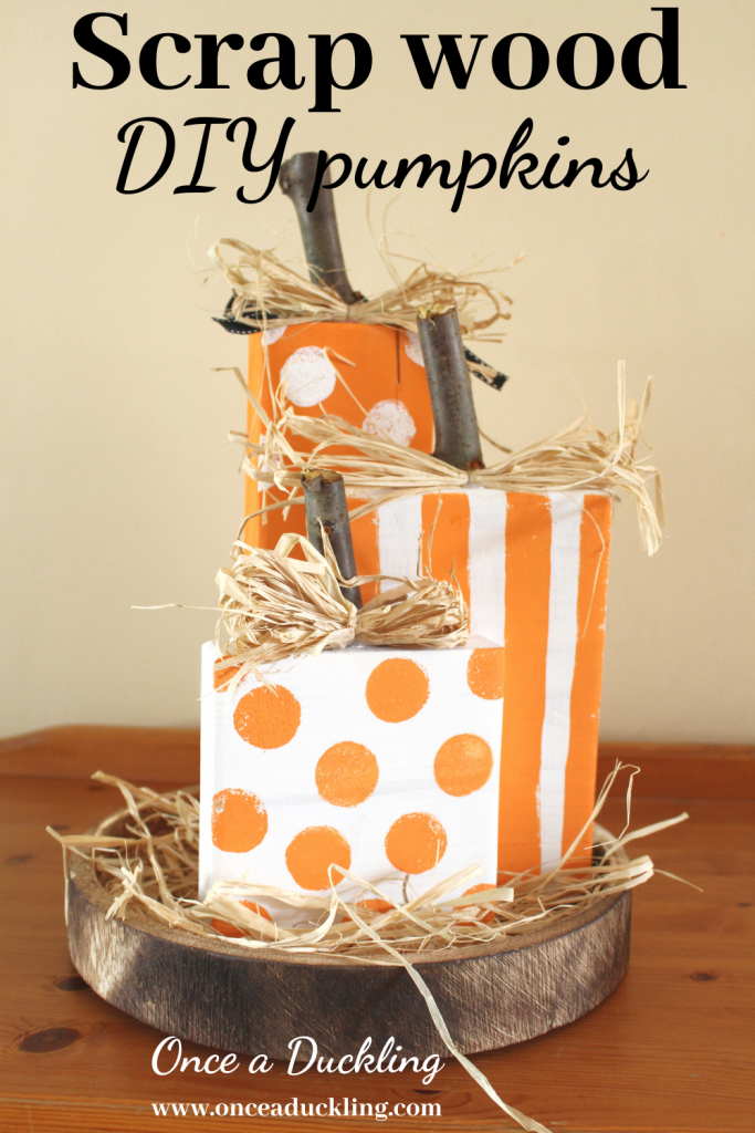 Pumpkins are a great way to add some fun to an autumn decor in your home.  And they don't have to be real!  Make your own rustic DIY pumpkins with some basic craft materials in no time at all.  Grab some sticks from the back garden and some scrap wood pieces to make your own.  #autumn #fall #pumpkin #pumpkins #rustic #fall decor #autumn decor