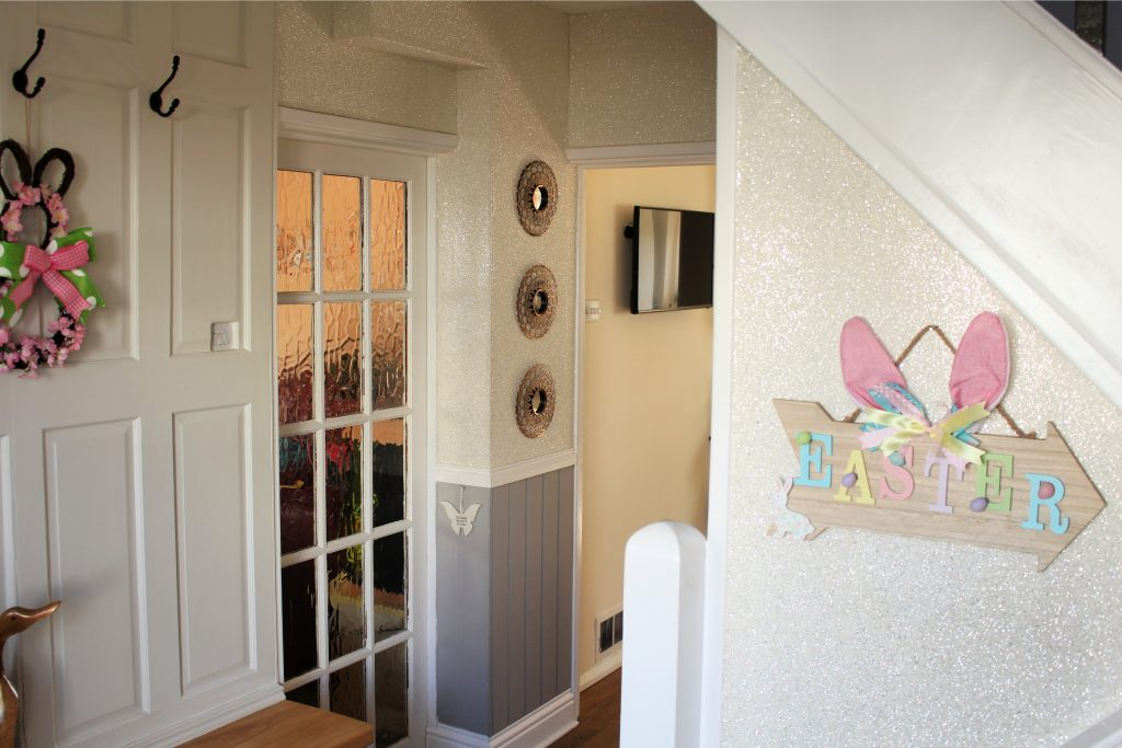 Floppy bunny ears easter sign on stairs
