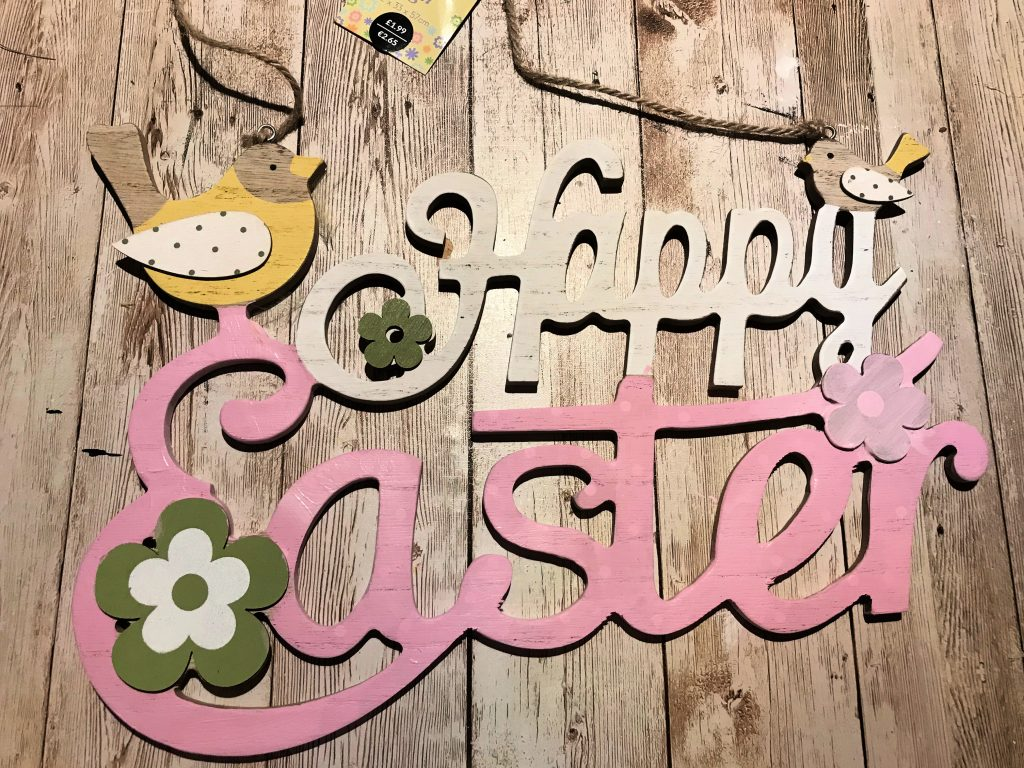 Happy Easter sign partly painted with pink paint