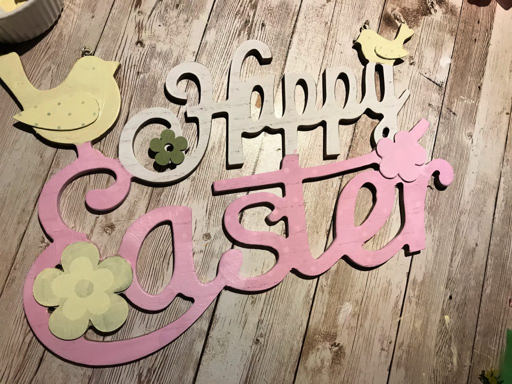 Happy Easter sign from The Range with pink and yellow paint