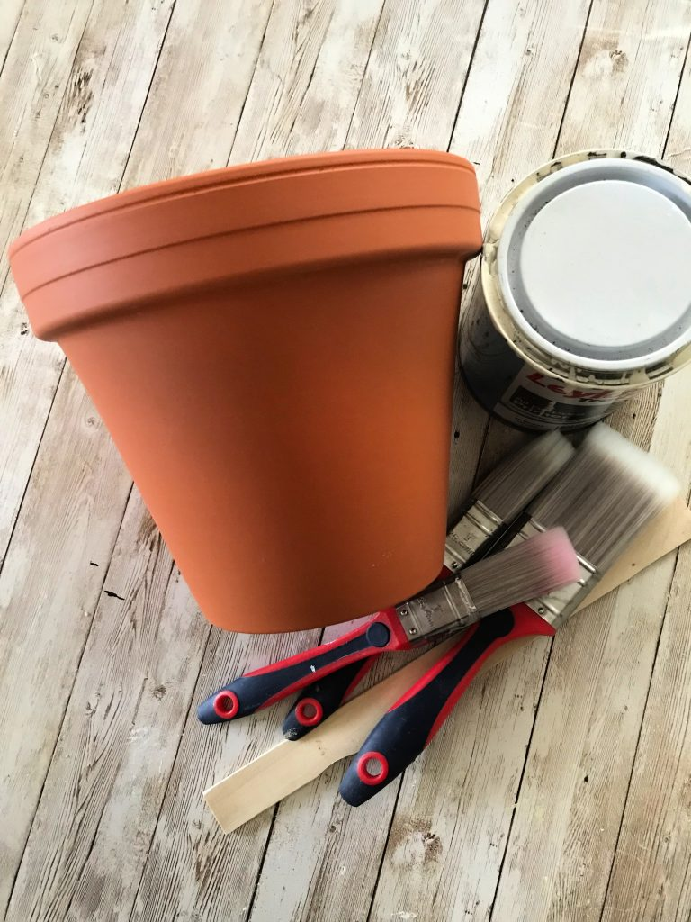 terracotta planter with brushes