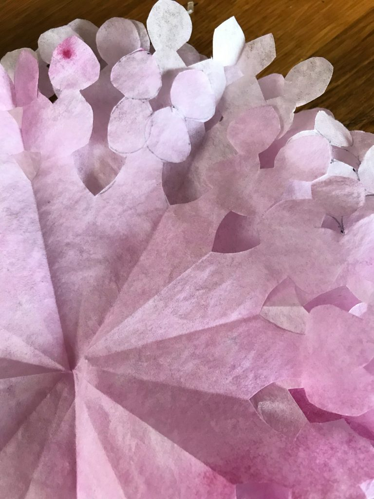 coffee filters cut into pettals