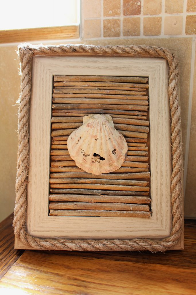 Picture frame makeover to budget coastal decoration with sea shell