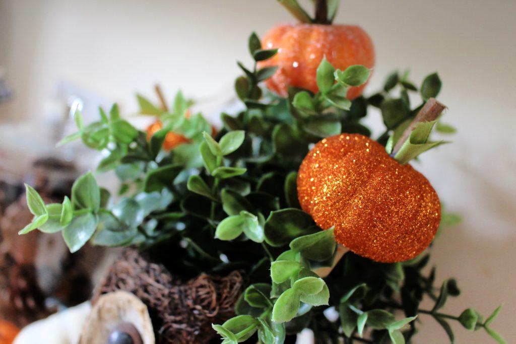 DIY glitter pumpkin picks in autumn display