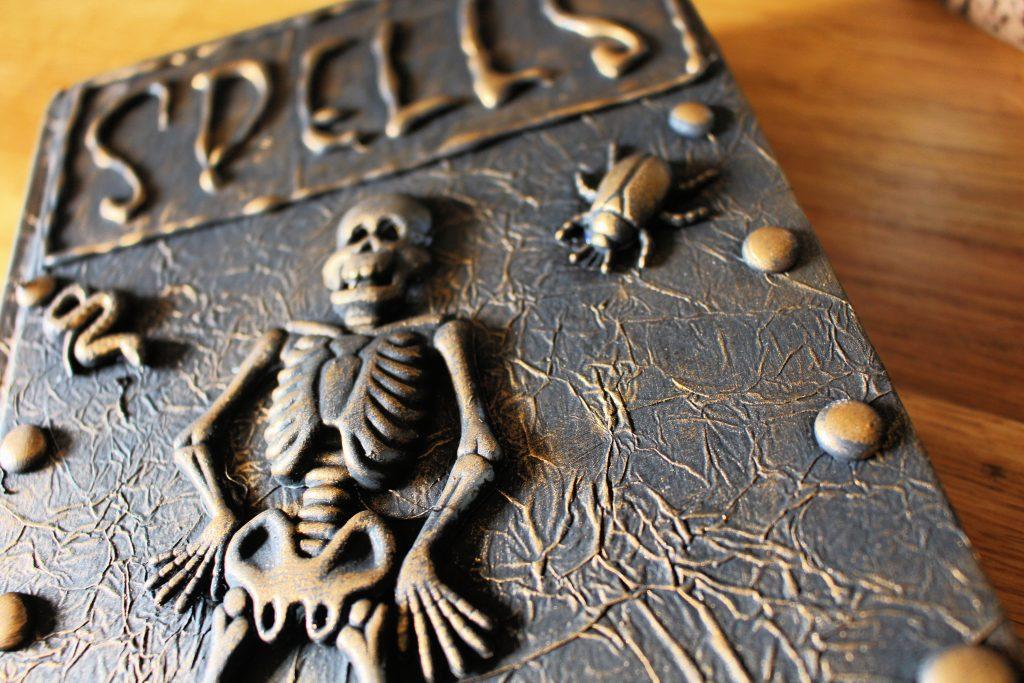DIY Halloween spell book with skeleton